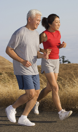 Mature couple jogging together