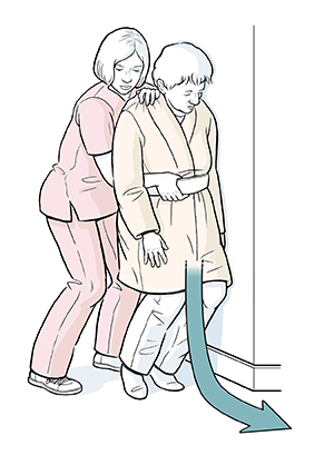 Healthcare provider guiding falling patient to floor.